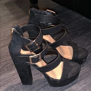 Black heels with gold buckles